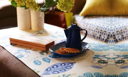 Prestigious Textiles -  Linden Fabric Collection - Table linen fabric in oatmeal and shaed of blue, floral and leaf design