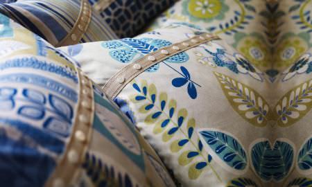 Prestigious Textiles -  Linden Fabric Collection - Selection of cushions - intricate leaf designs with embroidery in shades of oatmeal, green and blue