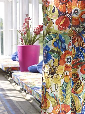 Prestigious Textiles -  Mardi Gras Fabric Collection - Curtains and two window seat cushions, all made with floral fabric in white, orange, gold and blue, with a pink flowerpot