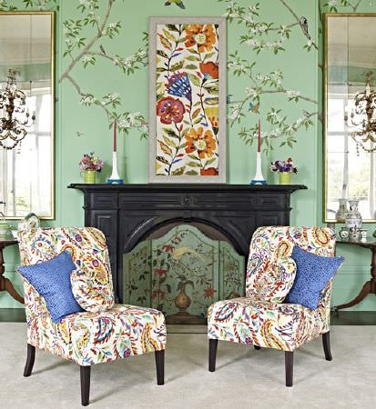 Prestigious Textiles -  Mardi Gras Fabric Collection - A red, orange and white floral framed picture with two co-ordinating paisley print padded chairs and four scatter cushions