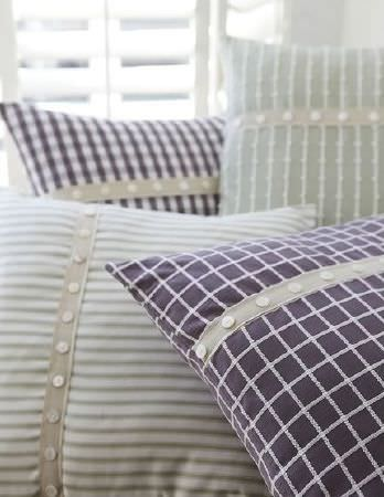Prestigious Textiles -  Marina Fabric Collection - Purple, white and green checked and striped cushions, each with a narrow strip of beige fabric and a row of tiny cream buttons