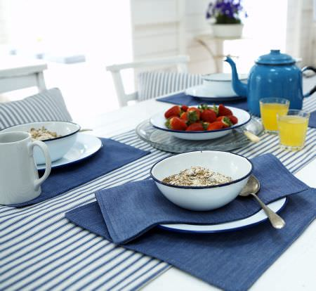 Prestigious Textiles -  Maritime Fabric Collection - Blue and white narrow tablecloth, with blue placemats and striped cushions from the Maritime fabric collection