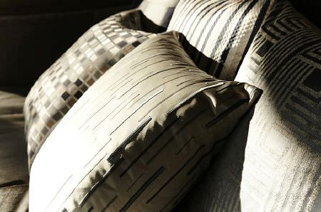 Prestigious Textiles -  Metropolis Fabric Collection - Cream cushion embroidered with stripes, with four other coordinating striped and square print cushions