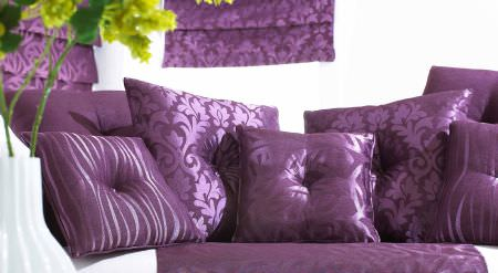 Prestigious Textiles -  Mexicana Fabric Collection - Purple cushion selection, with shiny purple patterning from the Mexicana Collection