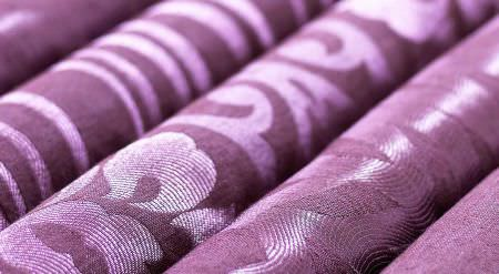 Prestigious Textiles -  Mexicana Fabric Collection - Mexicanan collection fabric rolls showing detailed stripe, curvy motifs