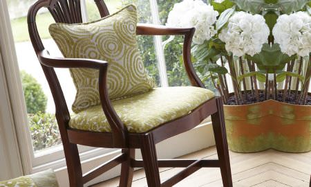Prestigious Textiles -  Mezzo Fabric Collection - straightbacked wooden chair with Mezzo Collection Green Velvet cushion, circular pattern