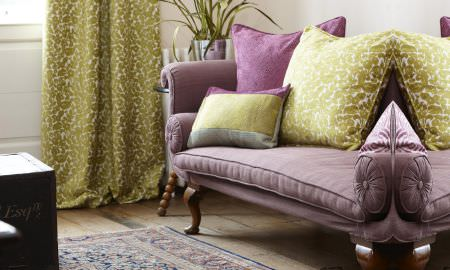 Prestigious Textiles -  Mezzo Fabric Collection - Formal lounge with Mauve velvet chaise longue, green velvet patterned curtains and a selection of cushions in green and purple
