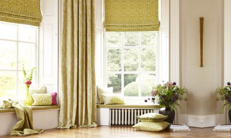Prestigious Textiles -  Mezzo Fabric Collection - Showcasing Mezzo collection Roman blinds and curtains in green patterned velvet