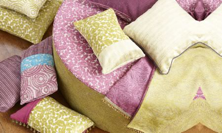 Prestigious Textiles -  Mezzo Fabric Collection - Selection of Mezzo Collection cushions in pink, blue, green and cream showing striped, circular and abstract patterns.