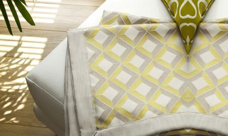 Prestigious Textiles -  Mode Fabric Collection - Table linen from Mode Fabric Collection - geometric designs in green, cream and grey