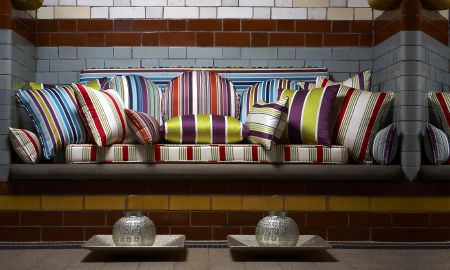 Prestigious Textiles -  Monte Carlo Fabric Collection - Selection of plush cushions in a range of striped designs, blues, reds, greens, purples, cream and grey - from the Montecarlo Collection
