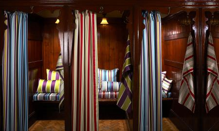 Prestigious Textiles -  Monte Carlo Fabric Collection - Montecarlo Collection striped curtains in blue and red, with complementary cushions