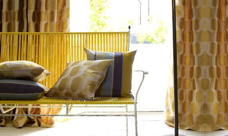 Prestigious Textiles -  Nouveau Fabric Collection - Informal bench cushions - striped and geometric designs in greys and golden yellow. Matching golden yellow curtains