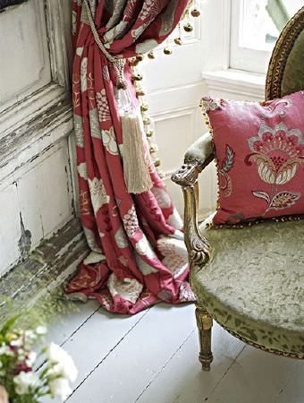 Prestigious Textiles -  Opera Fabric Collection - Red, cream and grey floral cushion and curtains with a cream tassel tieback and a dusky green armchair with a gold frame