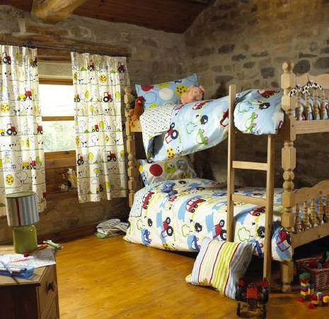 Prestigious Textiles -  Orchard Farm Fabric Collection - Childrens blue and white duvet and pillow covers with tractors and cars, and white curtains with drawings of tractors and animals