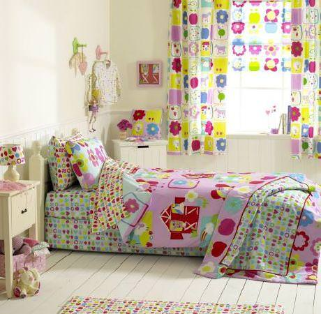 Prestigious Textiles -  Orchard Farm Fabric Collection - White pillows and duvets with red, pink, and blue flowers and hearts, a pink quilt with animals, and a colourful curtain with flowers
