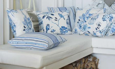 Prestigious Textiles -  Orient Fabric Collection - Selection of Orient Collection cushion designs - stripes, birds in trees, floral, all in blue and white