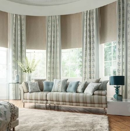 Prestigious Textiles -  Pemberley Fabric Collection - Extra wide striped sofa, large fluffy rug, plain, striped and patterned blue and white cushions, patterned curtains, side tables, blue lamp