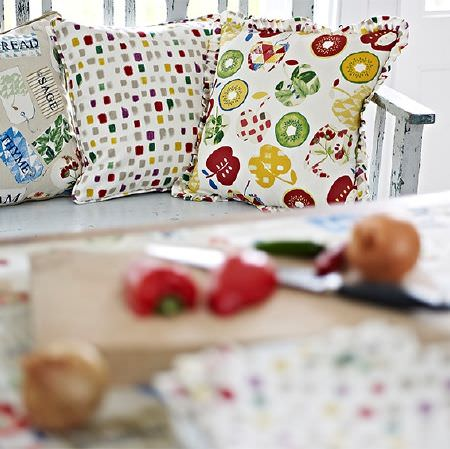 Prestigious Textiles -  Pickle Fabric Collection - Herb, fruit and dot print patterned cushions made in beige, blue, white, mustard, red and green, with chopped vegetables