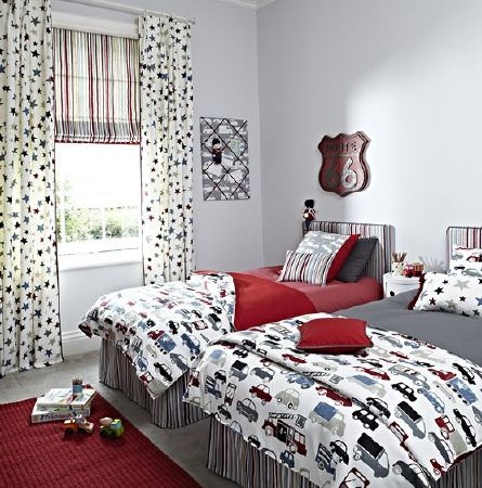 Prestigious Textiles -  Playtime Fabric Collection - Two beds with bedding, cushions, curtains, a blind and a rug, all in white, red and dark grey, with stripes, stars and cars