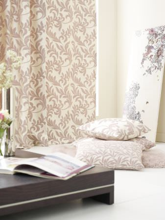 Prestigious Textiles -  Portland Fabric Collection - Champagne coloured curtain with a classic foliage pattern and champagne coloured pillows with leaf patterns from Portland fabric collection