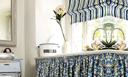 Prestigious Textiles -  Potting Shed Fabric Collection - Kitchen - Roman blind in vibrant blue, green and white stripes, and floral design fabric curtain