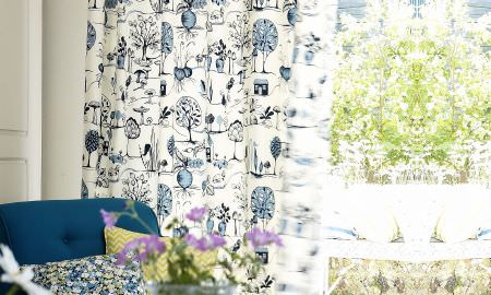 Prestigious Textiles -  Potting Shed Fabric Collection - White and blue curtain with tree motif from the Potting Shed Fabric Collection