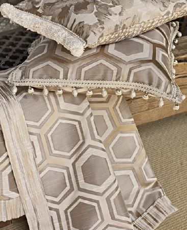 Prestigious Textiles -  Samarkand Fabric Collection - Shades of silver, cream and caramel making up hexagon, geometric and floral patterns on a throw and two fringed cushions