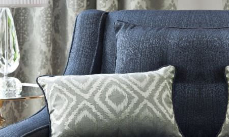 Prestigious Textiles -  San Marco Fabric Collection - Luxurious comfort - Navy blue armchair with matching cushion and silver accent cushion with diamond print