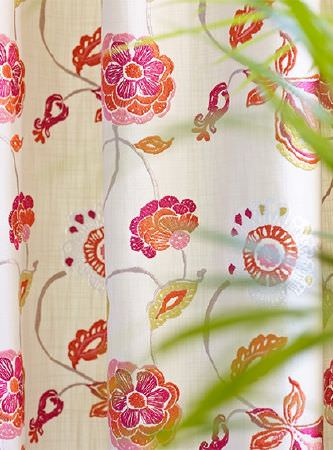 Prestigious Textiles -  Secret Garden Fabric Collection - Bold floral patterned curtains featuring a stylised bright orange and hot pink design on a plain white background