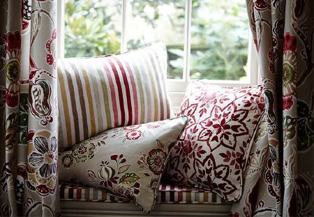 Prestigious Textiles -  Soleil Fabric Collection - Multicoloured striped scatter and seat cushions, with coordinating floral cushions and curtains, and a red and white patterned cushion