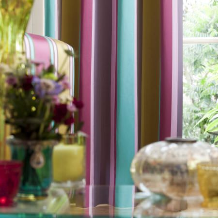 Prestigious Textiles -  Sophistication Fabric Collection - Close-up photo of a teal, pink and purple striped curtain for a modern designed house from the Sophistication fabric collection