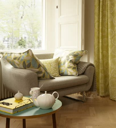 Prestigious Textiles -  South Bank Fabric Collection - Lime green curtain decorated with a modern pattern of circles and a set of lime green cushions with different designs
