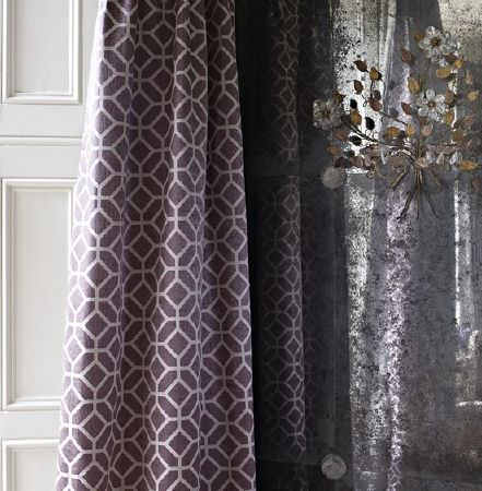Prestigious Textiles -  Spectrum Fabric Collection - Dark purple and pale grey geometric print curtains, beside a luxurious metallic silver curtain