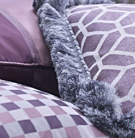 Prestigious Textiles -  Spectrum Fabric Collection - Shades of silver, lavender and purple making up three scatter cushions with stripes, checks, geometric prints and fringing