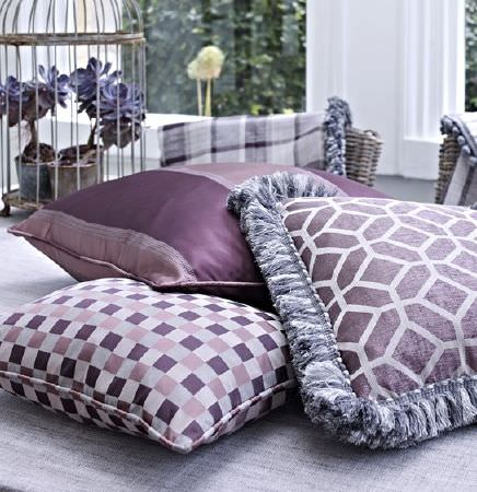 Prestigious Textiles -  Spectrum Fabric Collection - A throw and three cushions featuring stripes, checks, a checkerboard, geometric prints and fringing in shades of purple