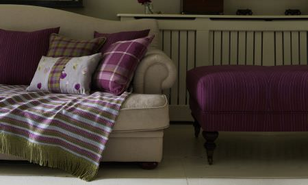 Prestigious Textiles -  Springfield Fabric Collection - Cream sofa with range of Springfield Collection cushions - floral, check, and block colour in greens, pink and grey, matching striped throw