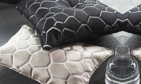 Prestigious Textiles -  Stardom Fabric Collection - Silver and black honeycomb pattern cushions from the Stardom Fabric Collection