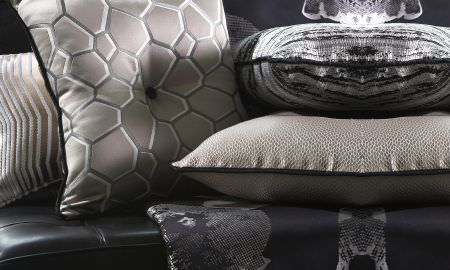 Prestigious Textiles -  Stardom Fabric Collection - Stardom Collection cushions - silver honeycomb pattern, stripes, with silver and black throw.
