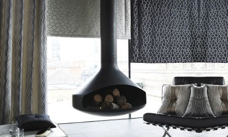 Prestigious Textiles -  Stardom Fabric Collection - Contrasting grey and black honeycomb design Roman blinds, floor length curtain and striped silver cushions from the Stardom Collection