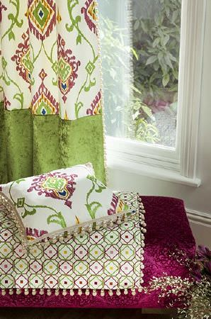 Prestigious Textiles -  Sumatra Fabric Collection - Cream, green and magenta patterned cushion, matching curtains with green velour bottom, geometric print throw, and patterned magenta seat