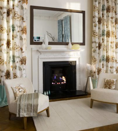 Prestigious Textiles -  West End Fabric Collection - White curtains with gold and brown detailed flowers, upholstered chairs with white cushions with gold flowers for a classic house setting