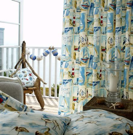 Prestigious Textiles -  Westward Ho Fabric Collection - White and blue curtains with images of ships and yachts, and a cushion with starfish and urchins