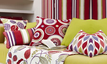 Prestigious Textiles -  Zest Fabric Collection - Zest Fabric Collection cushions circle, strip and leaf motifs in red, purple, white and green, with matching leaf patterned throw