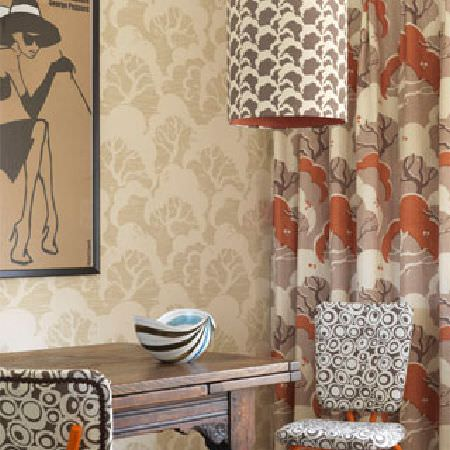 Rapture and Wright -  Rapture and Wright Collection - Beige and cream patterned walls, matching tree print curtains, retro print chairs, a brown and white light, and a wooden table