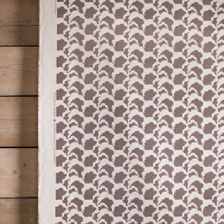 Rapture and Wright -  Rapture and Wright Collection - Wooden panels behind a piece of fabric printed with white and dark brown-grey cloud type shapes