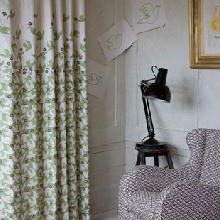Rapture and Wright -  Rapture and Wright Collection - Green, dark grey and white dove print curtains, a black lamp, a table, and an armchair with a small grey and white pattern