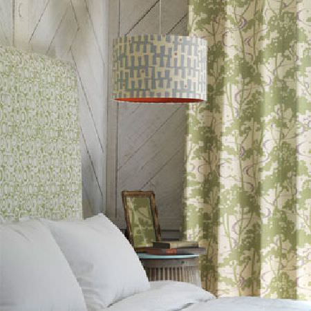 Rapture and Wright -  Rapture and Wright Collection - A pale blue and white lightshade, a bed with white bedding, a green and white headboard, matching curtains and a table