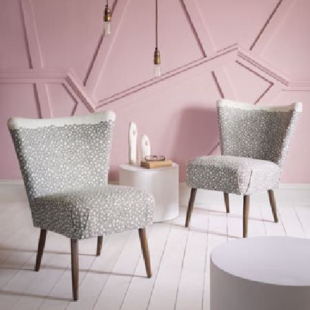 Rapture and Wright -  Rapture and Wright Collection - Two light grey and white patterned round chairs with wooden legs, a round white side table and a round mauve side table