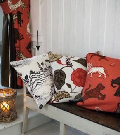 Sandberg -  Elin Fabric Collection - Wild animal print cushion, white, green and orange floral cushion, white and black landscape cushion, on bench, with wicker candle holder
